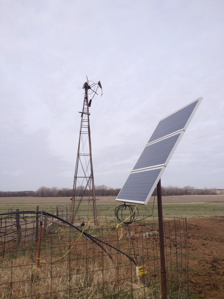 Here's the solar panel, for the pump on a well. You can see the old windmill.