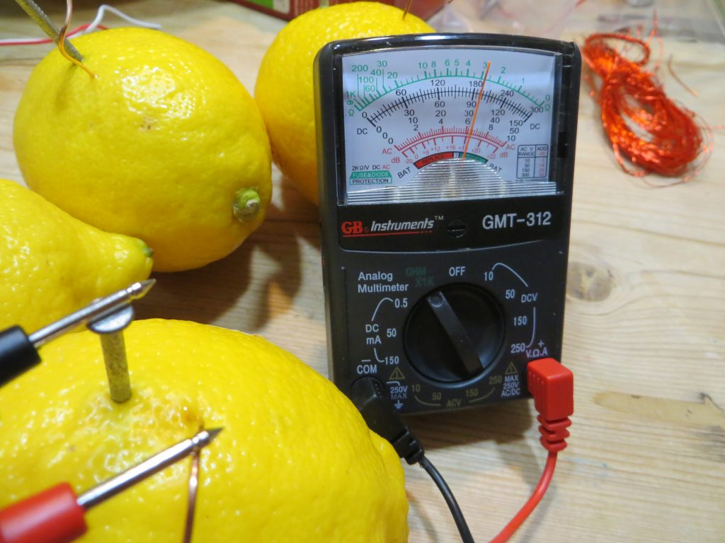 Testing current produced by a single lemon using a multimeter.